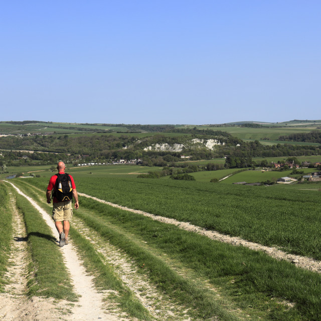 """""""Walker on the South Downs National Park, towards Amberley town, Sussex,..."""" stock image"""
