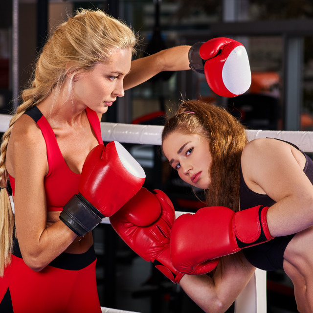 """Two boxing women workout in fitness class."" stock image"