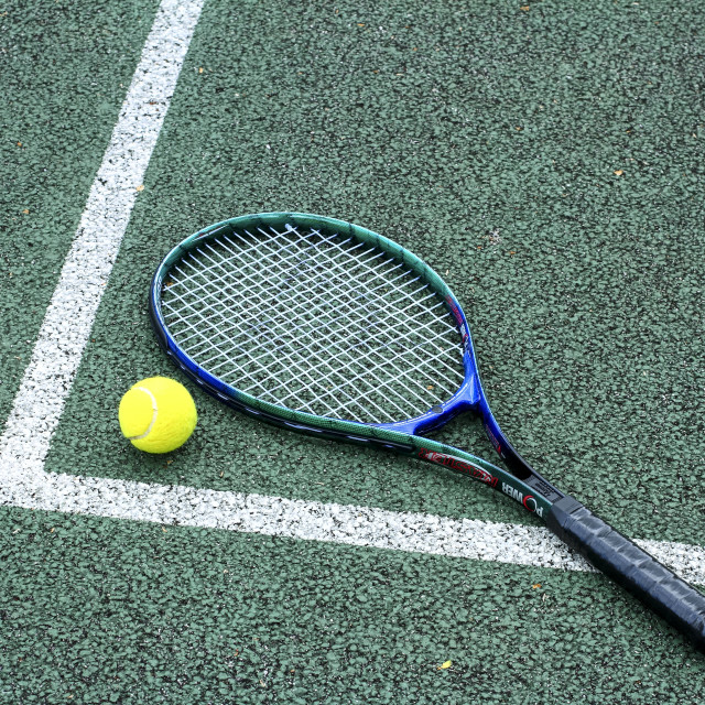 """""""Tennis racquet and ball on a hard tennis court"""" stock image"""