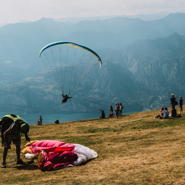 """08.08.2017 Monte Baldo, Italy, paraglider jumps"" stock image"