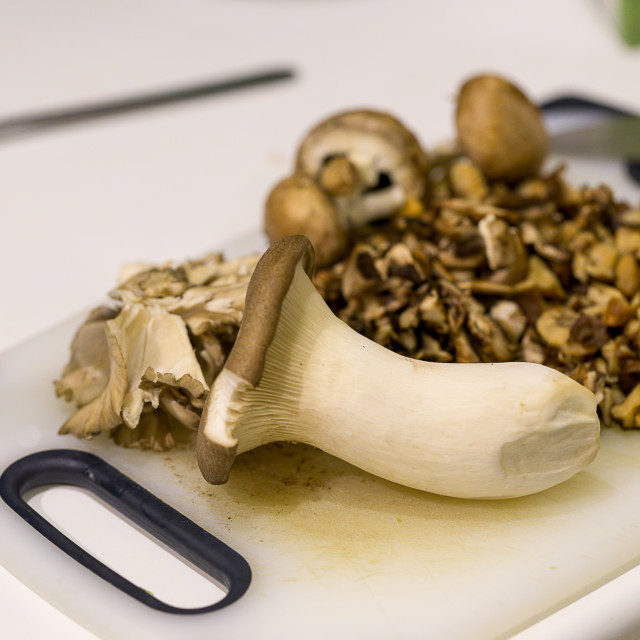 """A variety of mushrooms on a chopping board"" stock image"