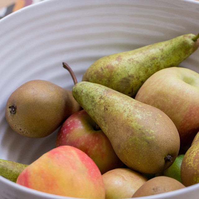 """A fruit bowl with apples, pears and kiwi fruits"" stock image"