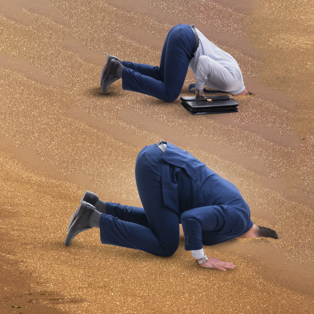 """""""Businessman hiding his head in sand escaping from problems"""" stock image"""