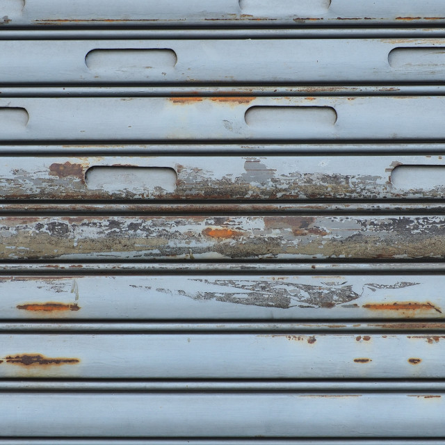 """""""Bluish rusty roller shutters with chipped paint"""" stock image"""