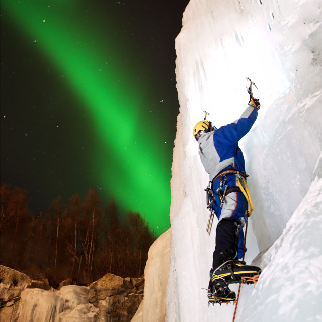 """Ice-climbing under Northern Lights"" stock image"
