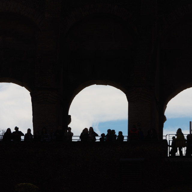 """Silhouettes at the Colosseum"" stock image"