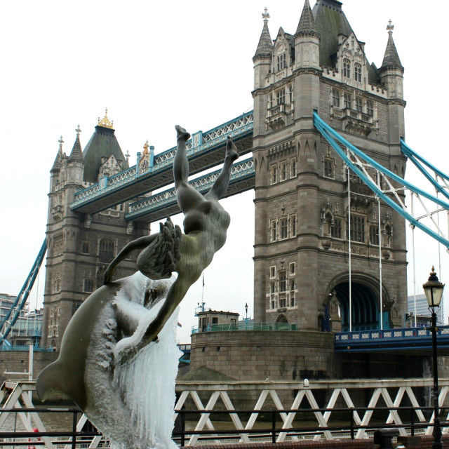 """""""Girl with the dolphin in front of Tower Bridge"""" stock image"""