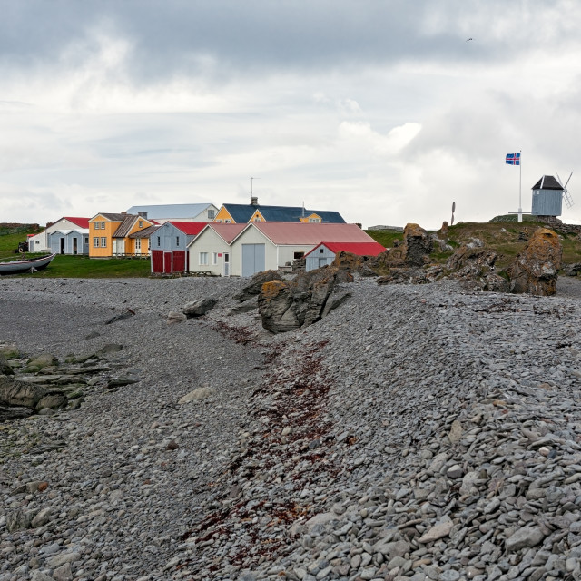 """""""Houses and windmill in Vigur island, Iceland"""" stock image"""