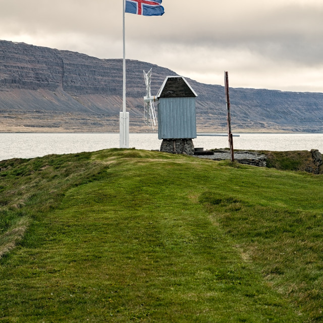 """Windmill and Icelandic flag in Vigur island, Iceland"" stock image"