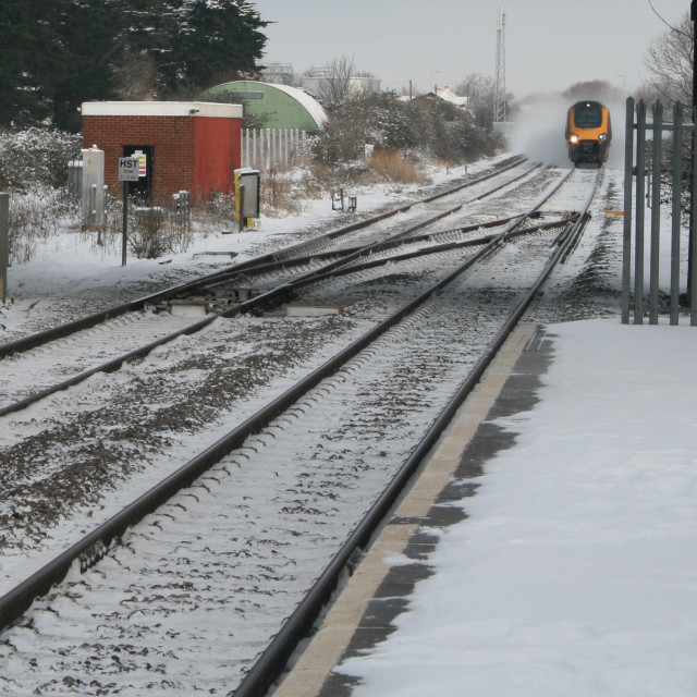 """""""A train in snowy weather"""" stock image"""