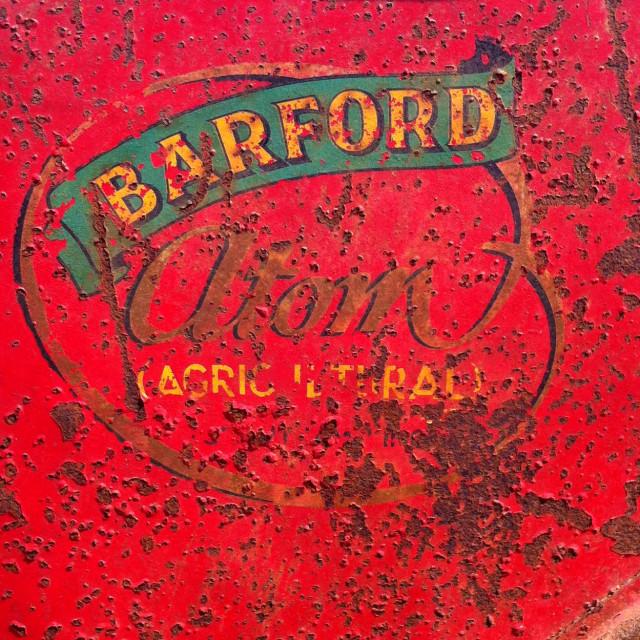 """Vintage farm machinery brand"" stock image"