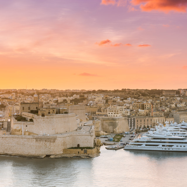 """Sunrise over Birgu and Grand Harbor in Malta"" stock image"