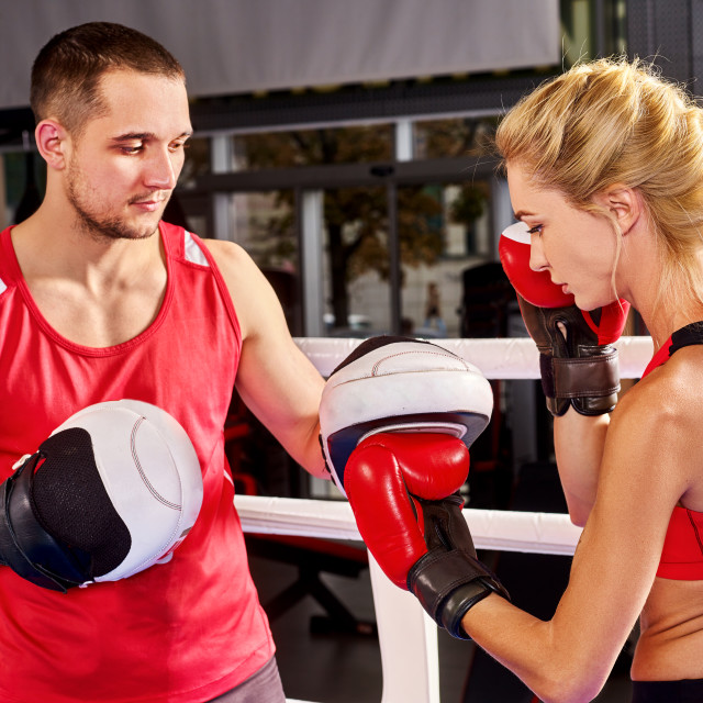 """Boxing workout woman in fitness class. Sport exercise two people."" stock image"