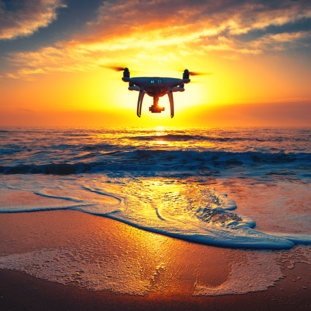 """""""Beautiful morning over the sea and flying drone"""" stock image"""