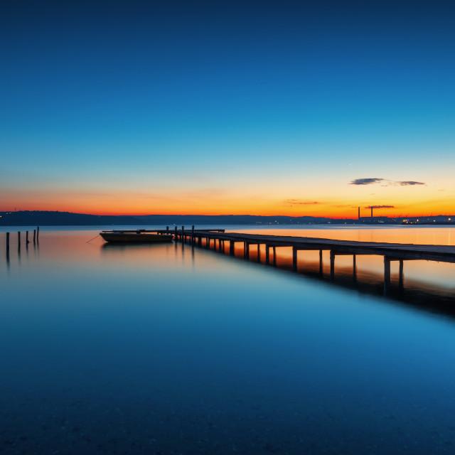 """Small Dock and Boat at the lake"" stock image"