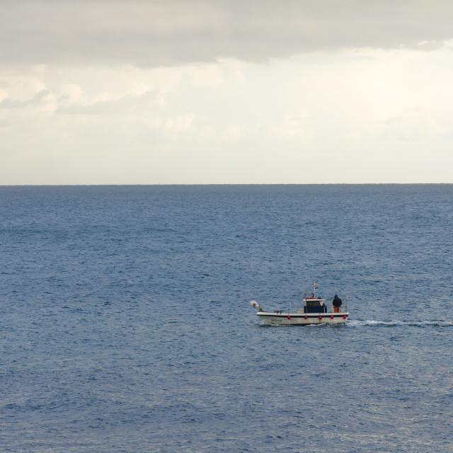 """""""a single fishing boat at sea"""" stock image"""