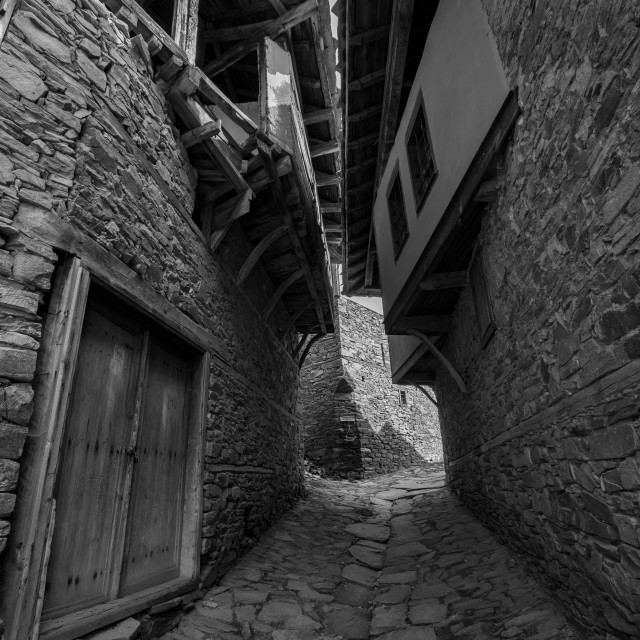 """Narrow medieval Bulgarian stone street with houses"" stock image"