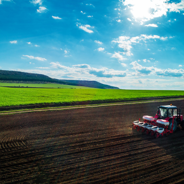 """""""Aerial view of tractors working on the harvest field"""" stock image"""