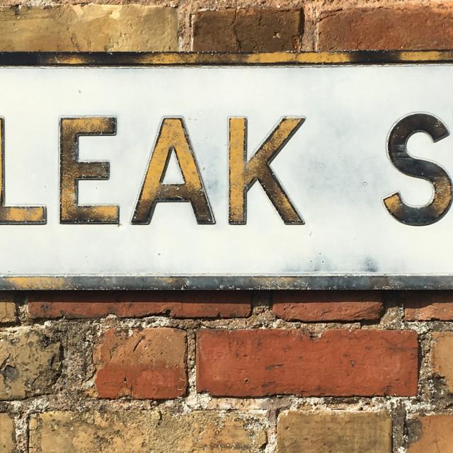 """Bleak Street road sign"" stock image"