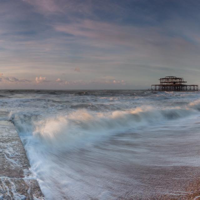 """Sunlit wave on Brighton beach"" stock image"