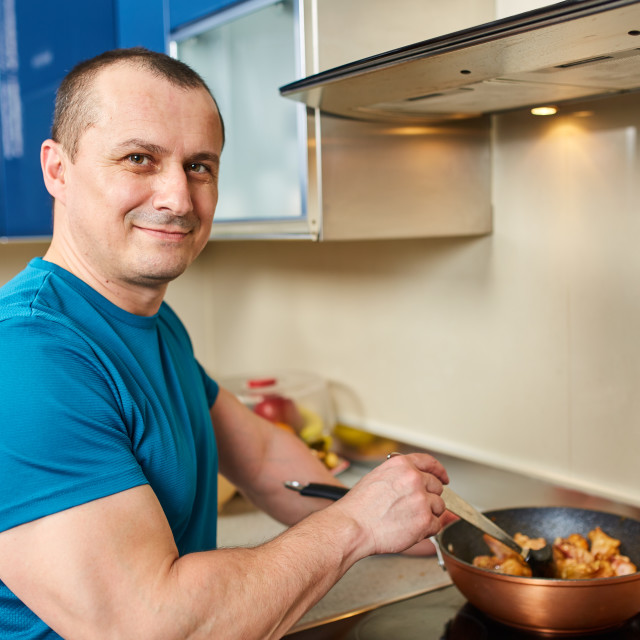 """""""Man cooking at home alone"""" stock image"""