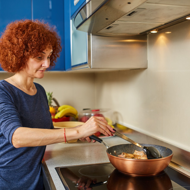 """""""Woman cooking at home"""" stock image"""
