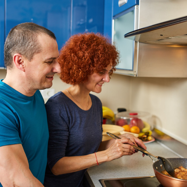 """""""Couple cooking together"""" stock image"""