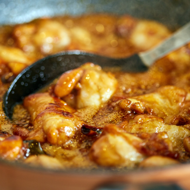 """""""Chicken wings in a wok, boiling"""" stock image"""