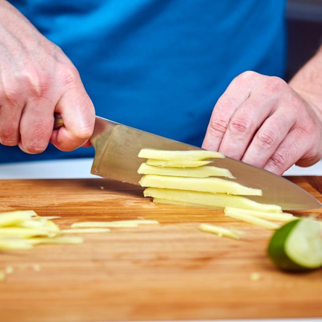 """""""Man chopping ginger"""" stock image"""