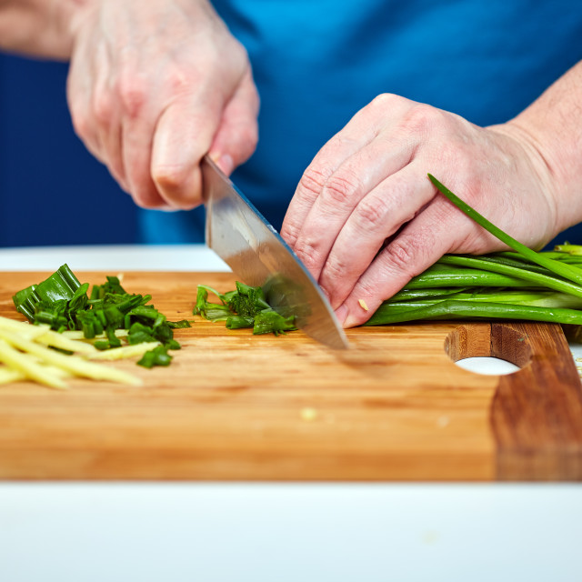 """Man chopping spring onions"" stock image"