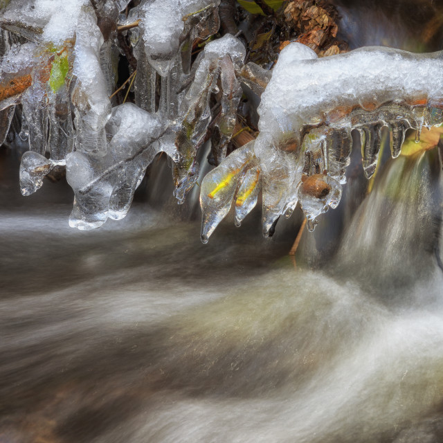 """Icicle in a stream"" stock image"