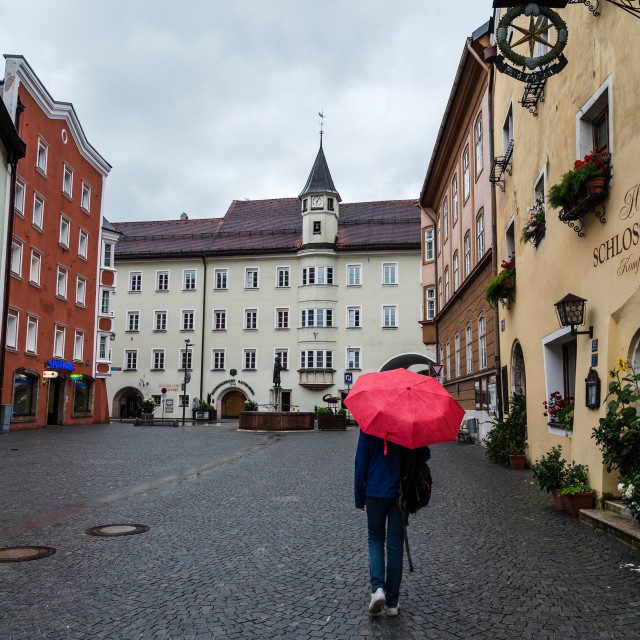 """""""Woman with red umbrella in the picturesque town of Rattenberg"""" stock image"""