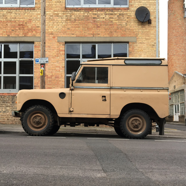 """""""Classic Land Rover parked on the street"""" stock image"""