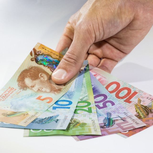 """Holding a bunch of New Zealand Dollars"" stock image"