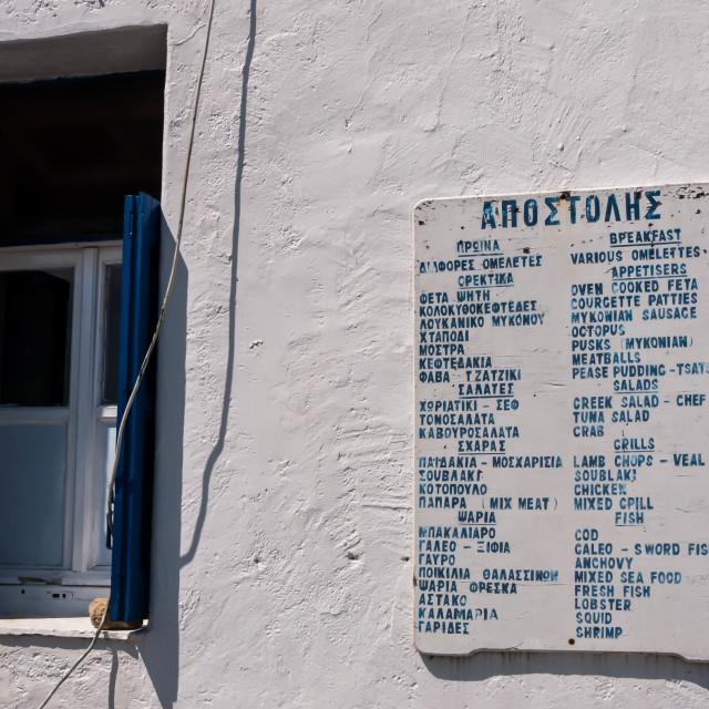 """Menu on Outside Wall of Greek Restaurant"" stock image"