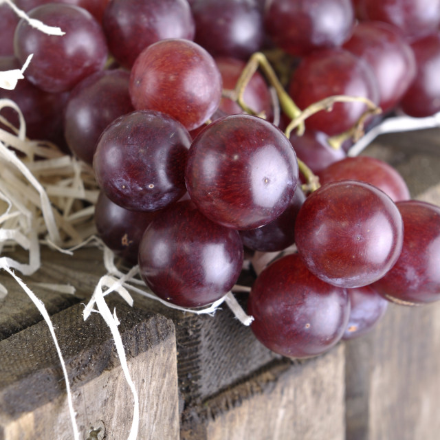 """""""bunch of grapes on a wooden box"""" stock image"""