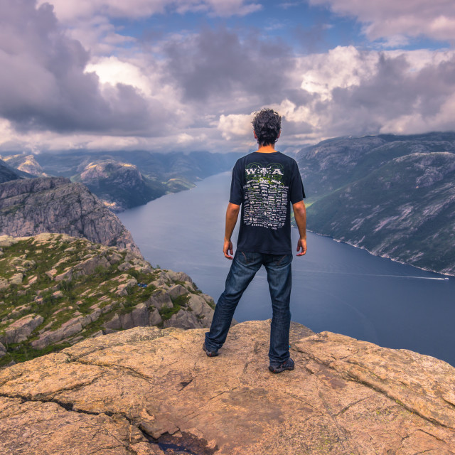 """July 20, 2015: Traveller at the summit of the Pulpit Rock, Norwa"" stock image"