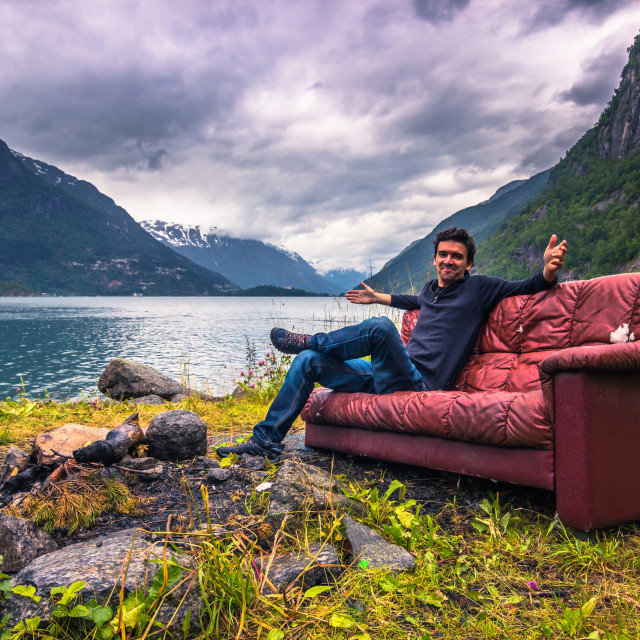 """""""July 21, 2015: Traveller relaxing in a red couch in the norwegia"""" stock image"""