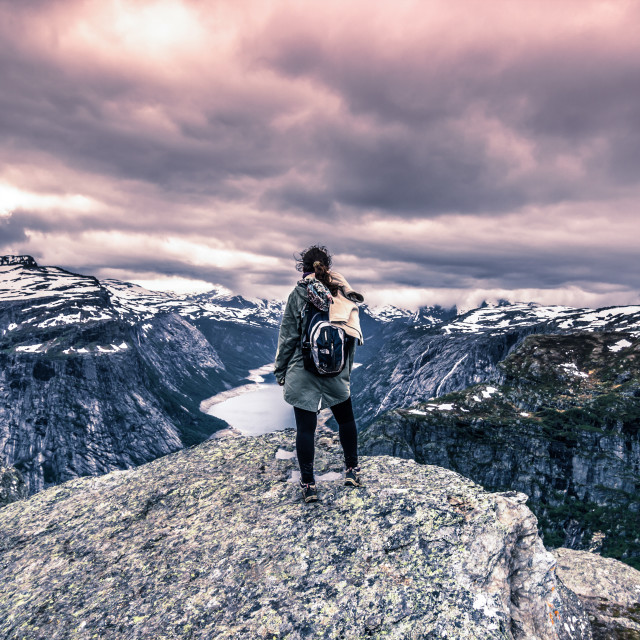 """July 22, 2015: Traveller at the edge of Trolltunga, Norway"" stock image"
