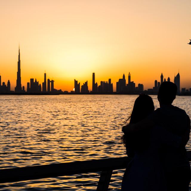 """Couple enjoying panoramic view of Dubai"" stock image"