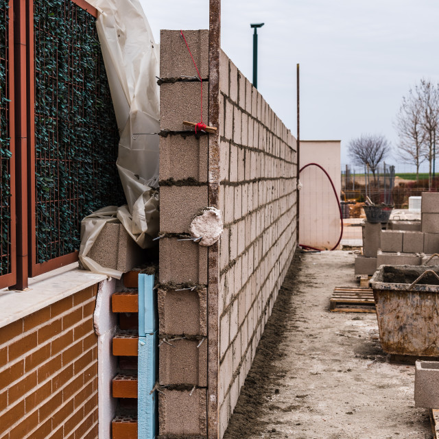 """Works of construction of reinforced concrete block wall with ins"" stock image"