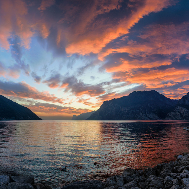 """burning skies on Lake Garda, Italy."" stock image"