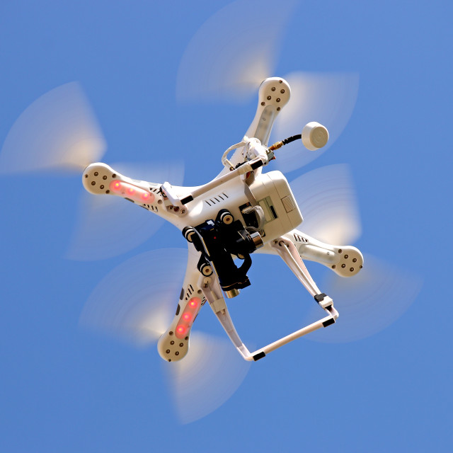 """""""Drone flying in the sky"""" stock image"""