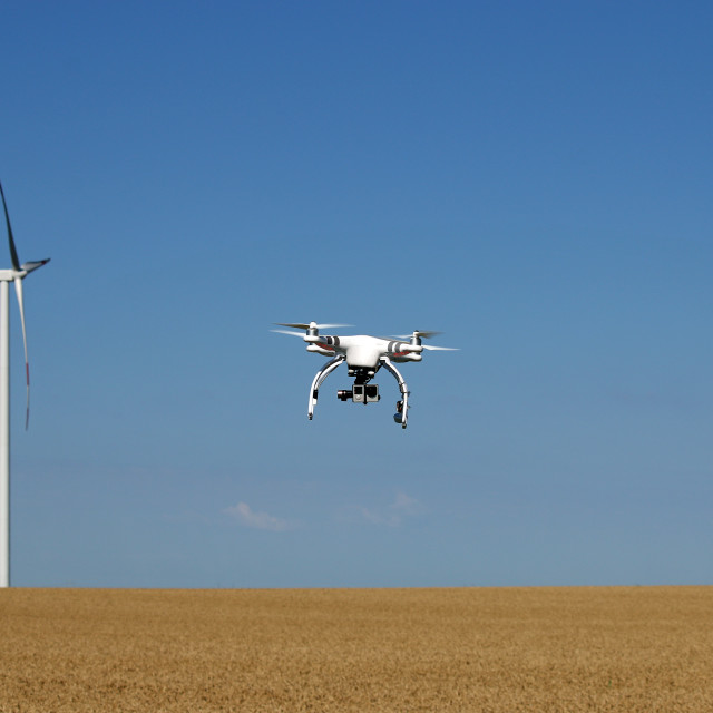 """""""drone flying over wheat field with wind turbine"""" stock image"""