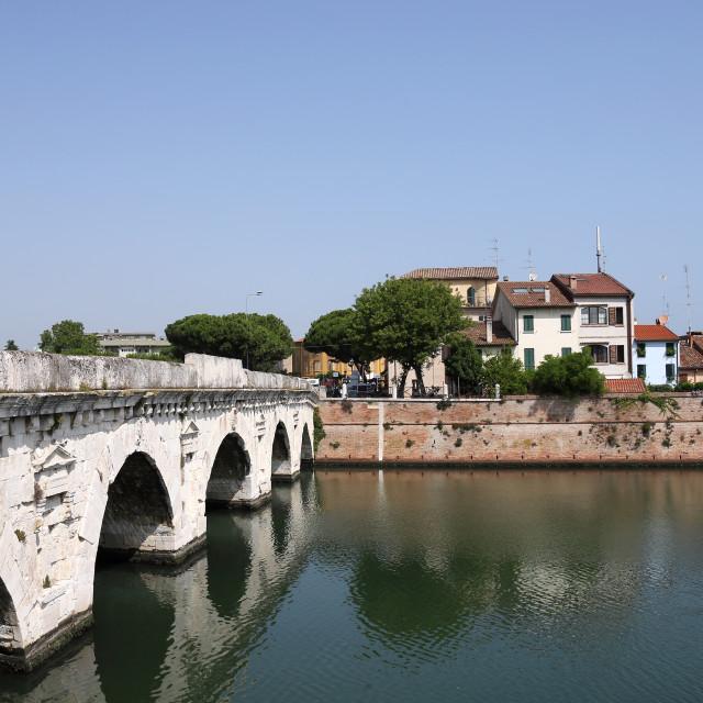 """Tiberius bridge and old buildings Rimini Italy"" stock image"