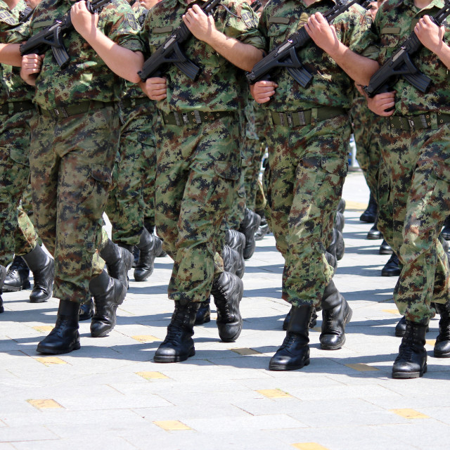 """""""Soldiers with camouflage uniforms marching with rifles"""" stock image"""