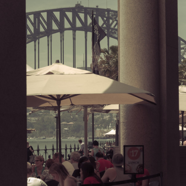 """Split toned image of people having lunch at restaurant on Circular Quay East with view of Sydney Harbour Bridge, Sydney, New South Wales, Australia"" stock image"