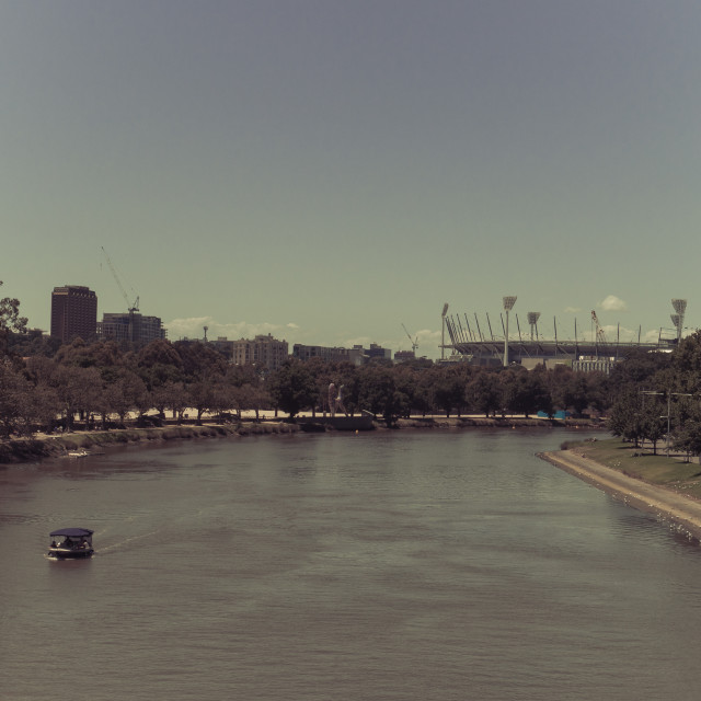"""Split toned image of the Yarra river with the Melbourne Cricket"" stock image"