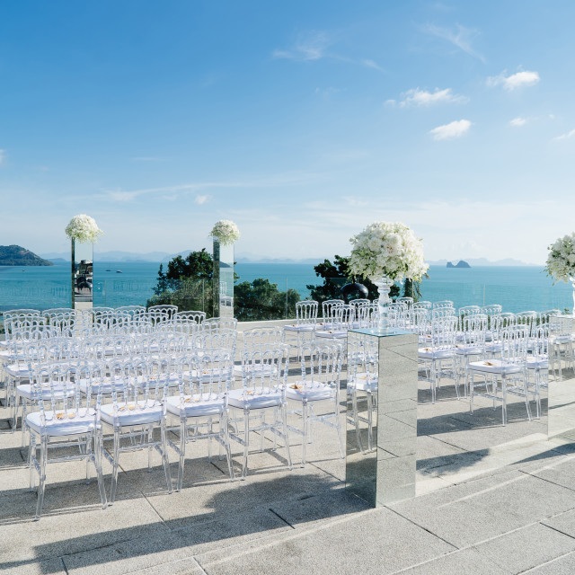 """Modern beach wedding venue setup with panoramic ocean view"" stock image"