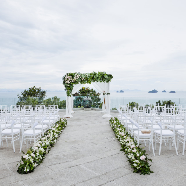 """Wedding venue setup, Roses, flowers, floral decoration with panoramic ocean view"" stock image"